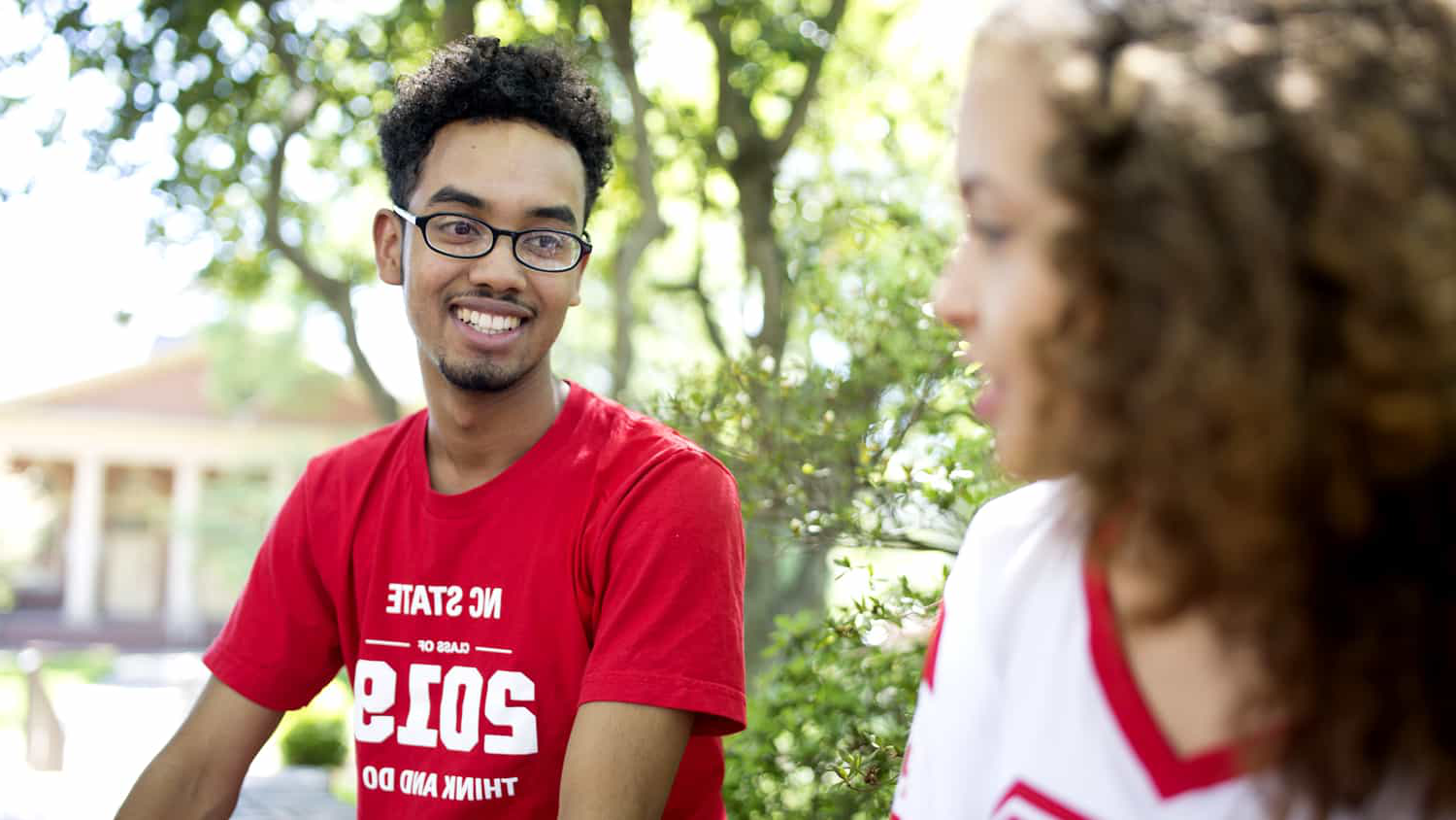 Diverse students talking on campus